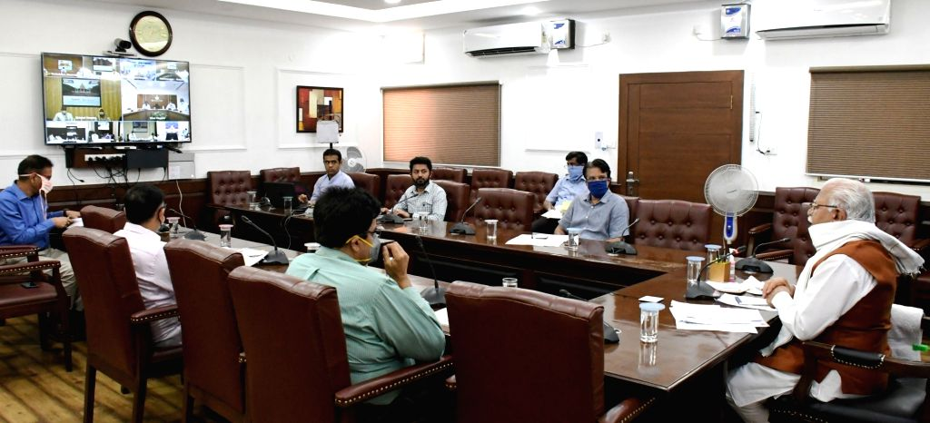 Haryana Chief Minister Manohar Lal Khattar interacts with farmer leaders through video conferencing in Chandigarh during the extended nationwide lockdown imposed to mitigate the spread of ... - Manohar Lal Khattar