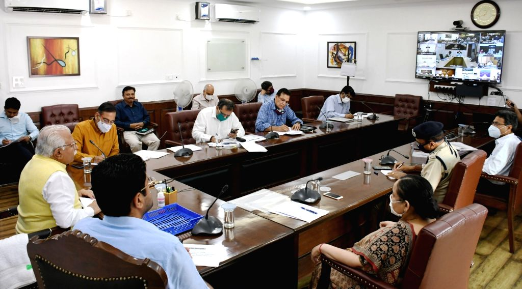 Haryana Chief Minister Manohar Lal Khattar presides over a meeting with all Deputy Commissioners, Commissioners of Police and Superintendents of Police through video conferencing in ... - Manohar Lal Khattar