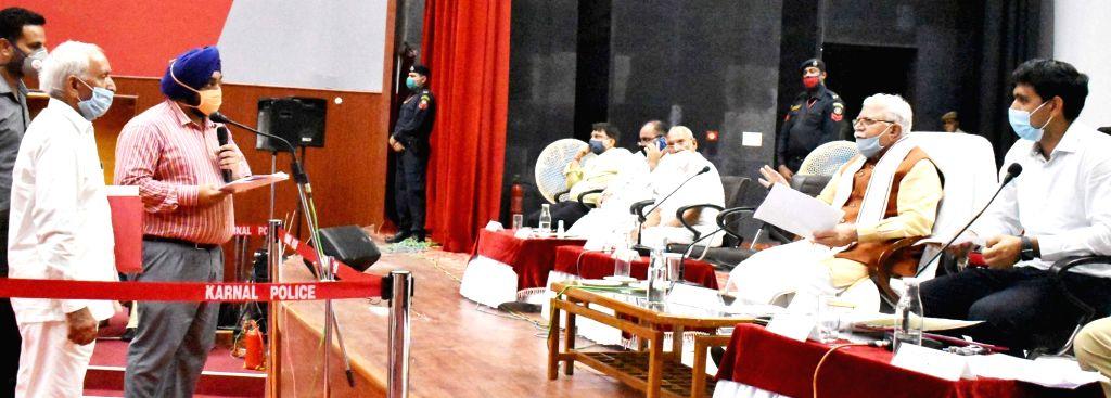 Haryana Chief Minister Manohar Lal Khattar redresses the grievances of people in Karnal on June 25, 2020. - Manohar Lal Khattar
