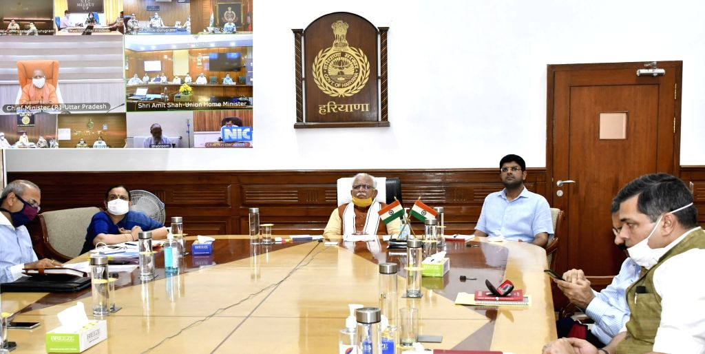 Haryana Chief Minister Manohar Lal Khattar attends a meeting presided by Union Home Minister Amit Shah from Delhi, regarding spreading of COVID-19 in Delhi and NCR Region, through video ... - Manohar Lal Khattar, Amit Shah and Secretary Keshni Arora