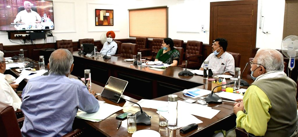 Haryana Chief Minister Manohar Lal Khattar attends a meeting chaired by Union Jal Shakti Minister Gajendra Singh Shekhawat from Delhi, through video conferencing in Chandigarh on July 3, ... - Manohar Lal Khattar and Gajendra Singh Shekhawat