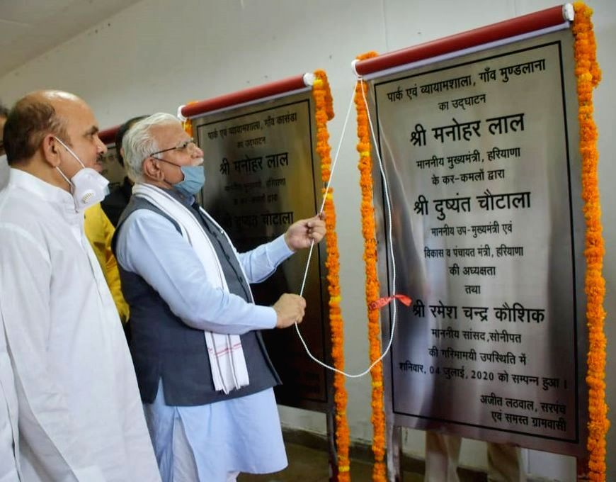 Haryana Chief Minister Manohar Lal Khattar unveils the plaque to inaugurate a park and vyamshala at Mundlana village in Sonipat district, on July 4, 2020. Also seen Member of Parliament ... - Manohar Lal Khattar