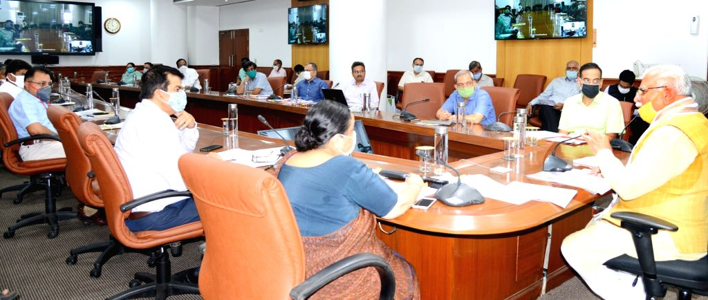 Haryana Chief Minister Manohar Lal Khattar presides over a review meeting of Transfer Policy of various departments at Chandigarh on July 31, 2020. - Manohar Lal Khattar