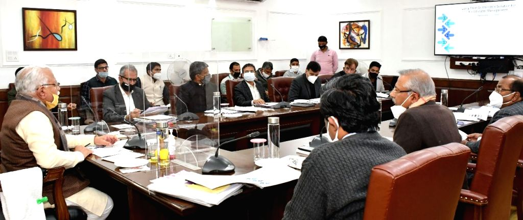 Haryana Chief Minister Manohar Lal Khattar presides over a meeting regarding sustainable solutions of Water Logging for Agricultural Land in the state, in Chandigarh on Dec 2, 2020. - Manohar Lal Khattar
