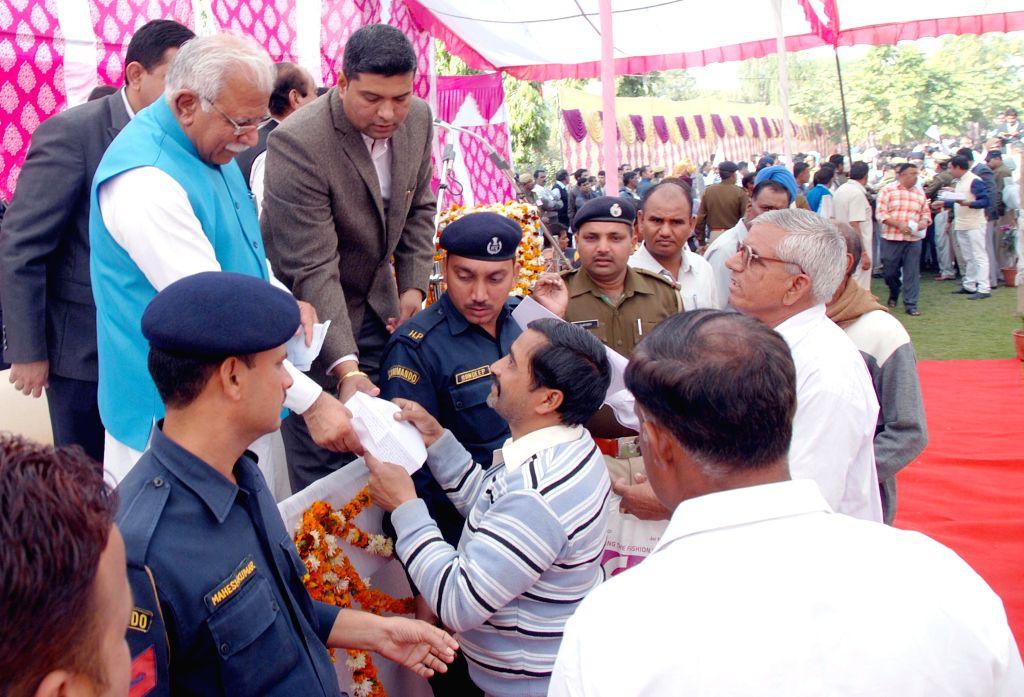 Haryana Chief Minister Manohar Lal Khattar listens to public grievances in Sirsa, Haryana on Dec 11, 2014. - Manohar Lal Khattar