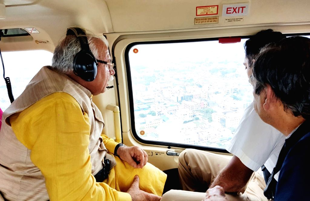 Haryana Chief Minister Manohar Lal Khattar conducts aerial survey of flood hit Gurgaon on Aug 1, 2016. - Manohar Lal Khattar