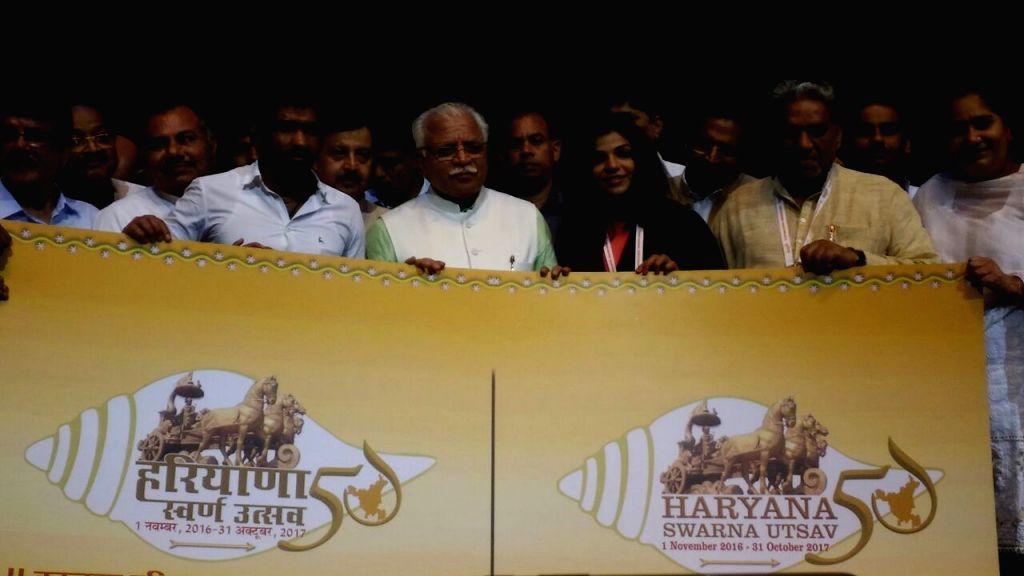 Haryana Chief Minister Manohar Lal Khattar unveils the logo of Haryana Swarna Jayanti Utsav in Gurgaon on Sept 17, 2016. - Manohar Lal Khattar
