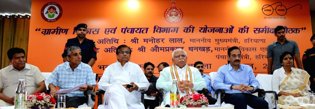 Haryana Chief Minister Manohar Lal Khattar presides over a meeting to review the development schemes of the Department of Rural Development and Panchayats, in Chandigarh on June 14, 2019. - Manohar Lal Khattar