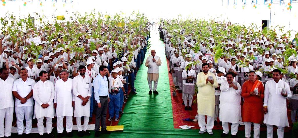 Haryana Chief Minister Manohar Lal Khattar addresses during 2019 Paudhagiri Abhiyan, in Kurukshetra on July 16, 2019. - Manohar Lal Khattar