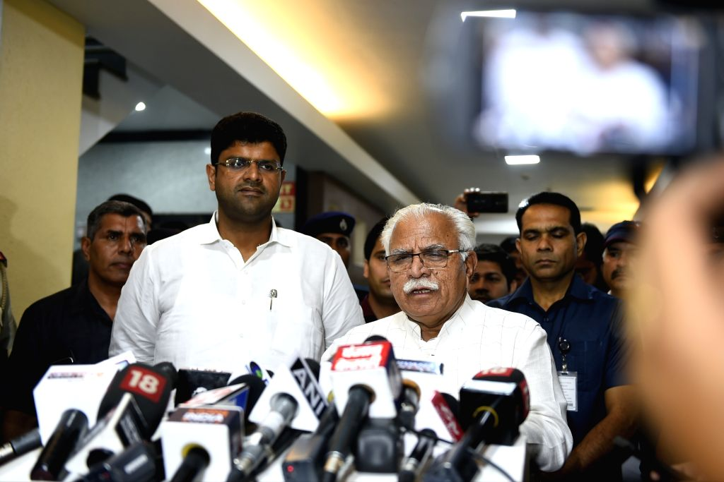 Haryana Chief Minister Manohar Lal Khattar accompanied by Deputy Chief Minister Dushyant Chautala, addresses a press conference in New Delhi, on Oct 29, 2019. - Manohar Lal Khattar