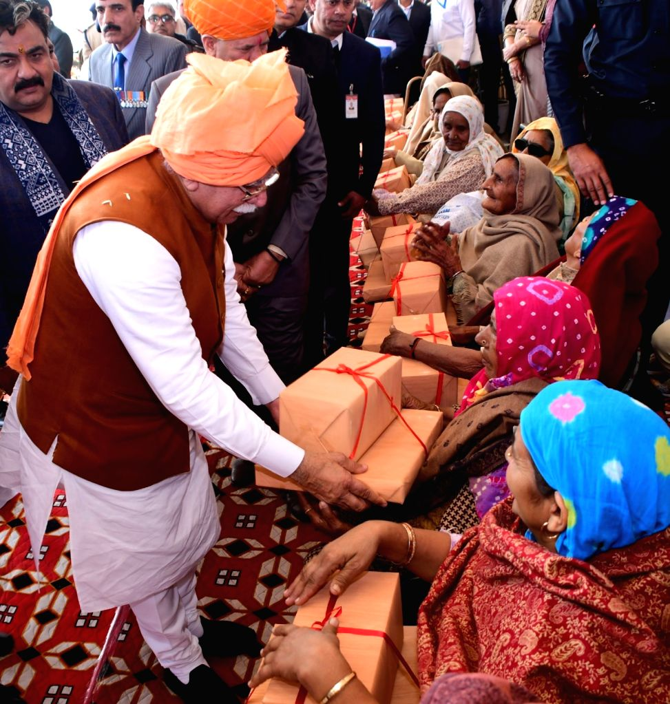 Haryana Chief Minister Manohar Lal Khattar honours war widows during the 71st Republic Day celebrations at Jind on Jan 26, 2020. - Manohar Lal Khattar
