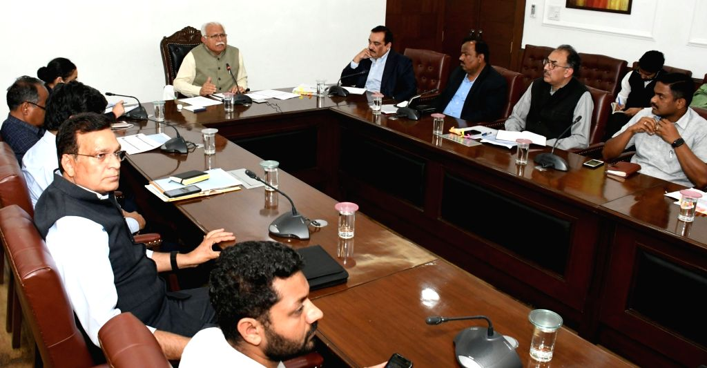 Haryana Chief Minister Manohar Lal Khattar presides over a meeting for ensuring availability of essential commodities with Deputy Commissioners, representatives of Traders' Associations, ... - Manohar Lal Khattar
