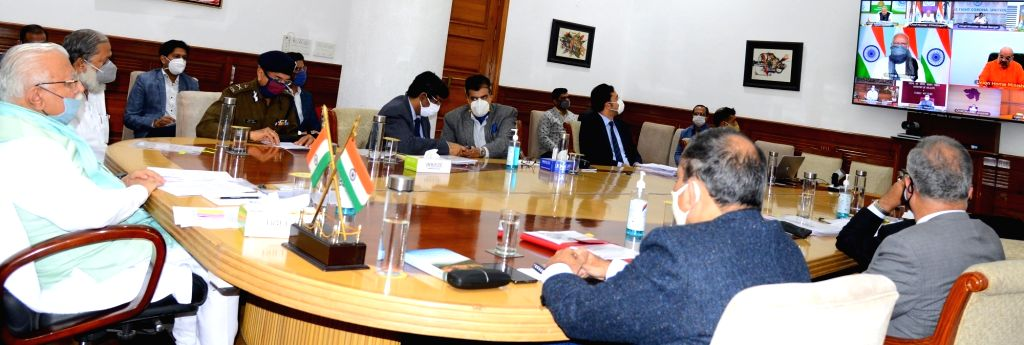 Haryana Chief Minister Manohar Lal Khattar and State Health Minister Anil Vij attend the high-level meeting chaired by Prime Minister Narendra Modi to take stock of the Covid-19 situation ... - Manohar Lal Khattar and Narendra Modi