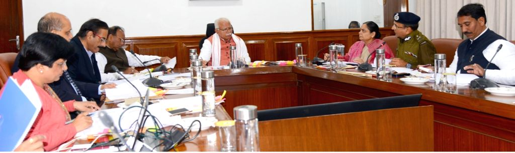 Haryana Chief Minister Manohar Lal khattar at a review meeting of State Level Vigilance and Monitoring Committee of Scheduled Castes and Scheduled Tribes,(SC/ST) in Chandigarh, Haryana on ... - Manohar Lal and Keshni Anand Arora