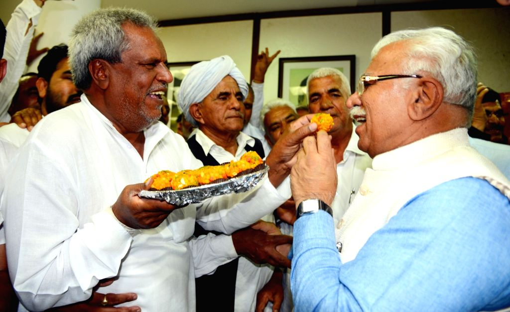 Haryana Chief Minister Manohar Lal Khattar being offered sweets by Khap leaders after the Haryana Backward Classes (Reservation in Government Jobs and admissions in Government Jobs and ... - Manohar Lal Khattar