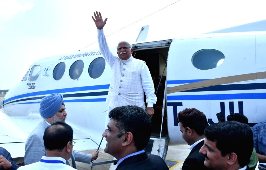 Haryana Chief Minister Manohar Lal Khattar boards the first flight from Hisar Airport to travel to Chandigarh International Airport on Sep 3, 2019. - Manohar Lal Khattar