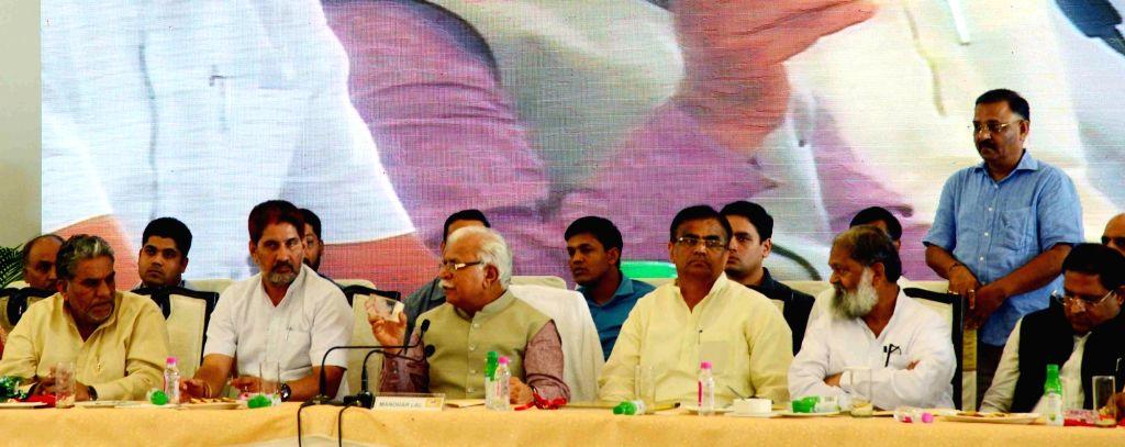 Haryana Chief Minister Manohar Lal Khattar (C) addresses during state lavel meeting on Harayana Swarna Jayanti celebrations in Panchkula on Sept 27, 2016. - Manohar Lal Khattar