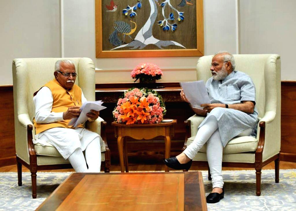 Haryana Chief Minister Manohar Lal Khattar calls on Prime Minister Narendra Modi in New Delhi on April 22, 2017. - Manohar Lal Khattar and Narendra Modi