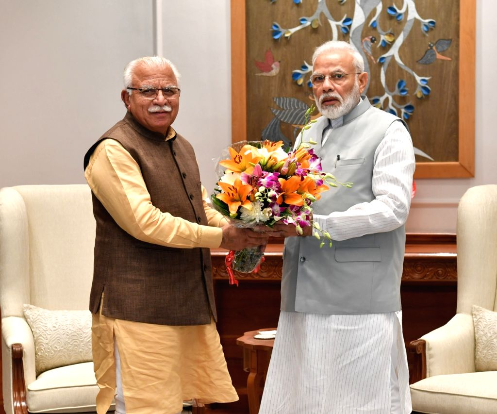 Haryana Chief Minister Manohar Lal Khattar calls on Prime Minister Narendra Modi in New Delhi on Oct 30, 2019. - Manohar Lal Khattar and Narendra Modi