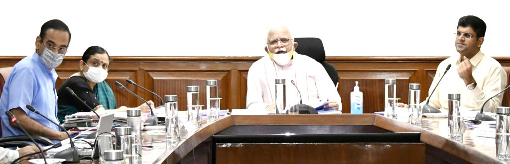 Haryana Chief Minister Manohar Lal Khattar chairs a meeting of the State Level District Development Coordination and Monitoring Committee (DISHA), in Chandigarh on July 13, 2020. Also ... - Manohar Lal Khattar