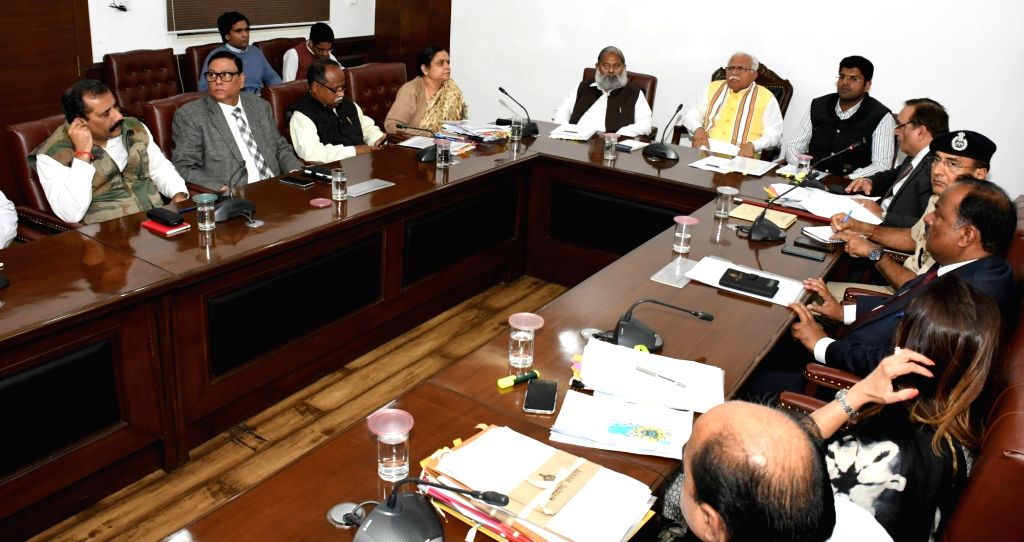 Haryana Chief Minister Manohar Lal Khattar, Deputy Chief Minister Dushyant Chautala and Health Minister Anil Vij preside over a meeting to review the steps being taken to check the spread ... - Manohar Lal Khattar