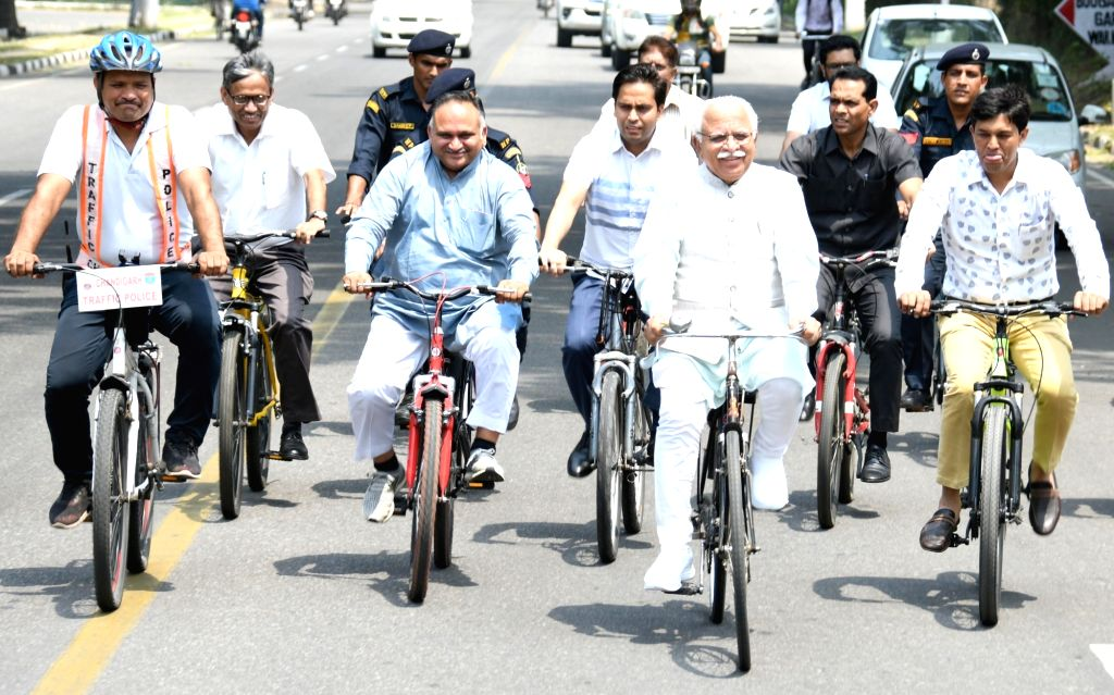 Haryana Chief Minister Manohar Lal Khattar rides a bicycle to reach his office on World Bicycle Day, in Chandigarh on June 3, 2019. - Manohar Lal Khattar