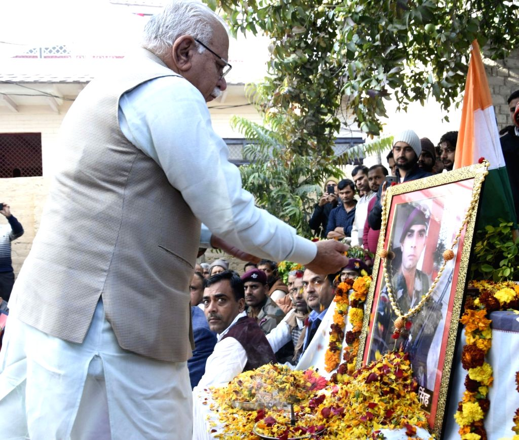Haryana Chief Minister Manohar Lal pays tribute to martyr Naik Sandeep Kaliraman, one of the 40 CRPF personnel killed in 14 Feb Pulwama militant attack; in Atali village of state's ... - Manohar Lal