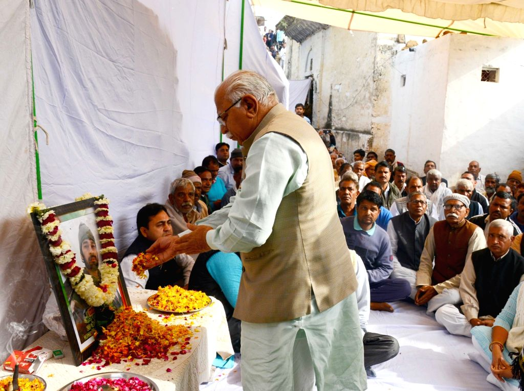 Haryana Chief Minister Manohar Lal pays tribute to martyr Hari Singh, one of the 40 CRPF personnel killed in 14 Feb Pulwama militant attack; in Rajgarh village of Rewari district on Feb 21, ... - Manohar Lal and Hari Singh