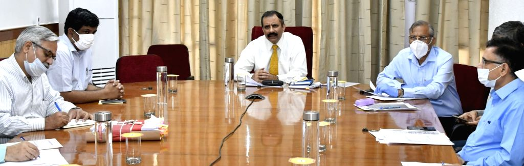 Haryana Chief Secretary Vijai Vardhan presides over a meeting with Deputy Commissioners of various Districts through video conferencing to review the action taken and strategy for crop ...