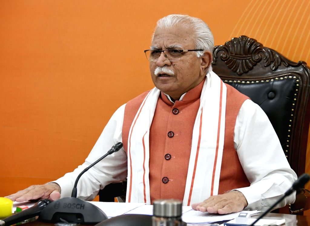 Haryana CM greets people, does yoga in home