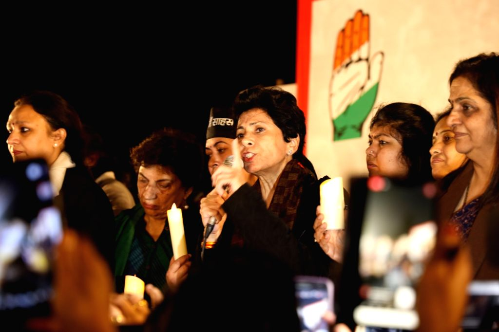 Haryana Congress President Kumari Selja addresses during a protest march organised by the party to Parliament over increasing incidents of crimes against women, in New Delhi on Dec 13, ...