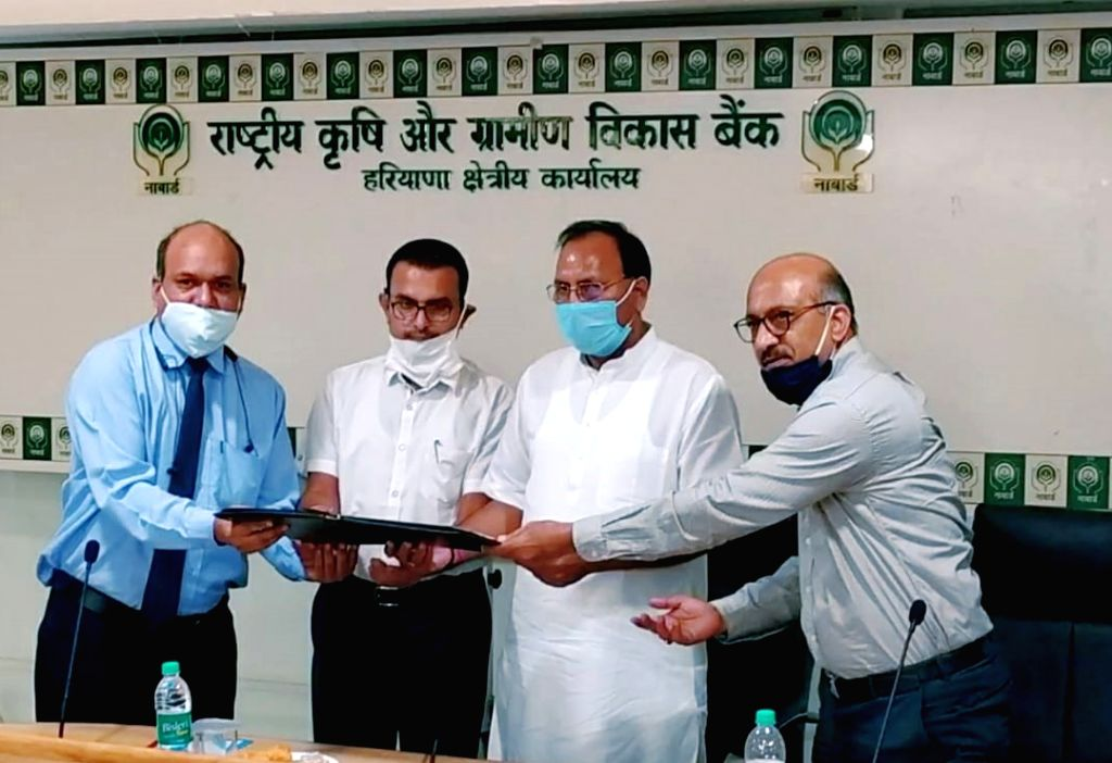 Haryana Cooperation Minister Dr. Banwari Lal presenting approval letter to Managing Director of Haryana State Cooperative Bank to convert 95 Primary Agricultural Credit Societies into ... - D