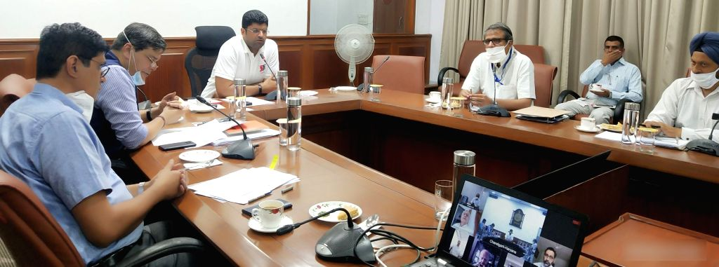 Haryana Deputy Chief Minister and Aviation Minister Dushyant Chautala presides over a meeting regarding upgradation of Hisar Airport, through video conferencing in Chandigarh on June 24, ... - Dushyant Chautala