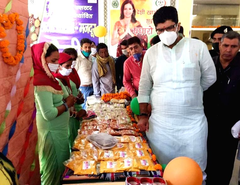 Haryana Deputy Chief Minister Dushyant Chautala inspects the products prepared by women self-help groups at an exhibition organised at the inauguration of Atal Kisan-Mazdoor Canteen at in ... - Dushyant Chautala