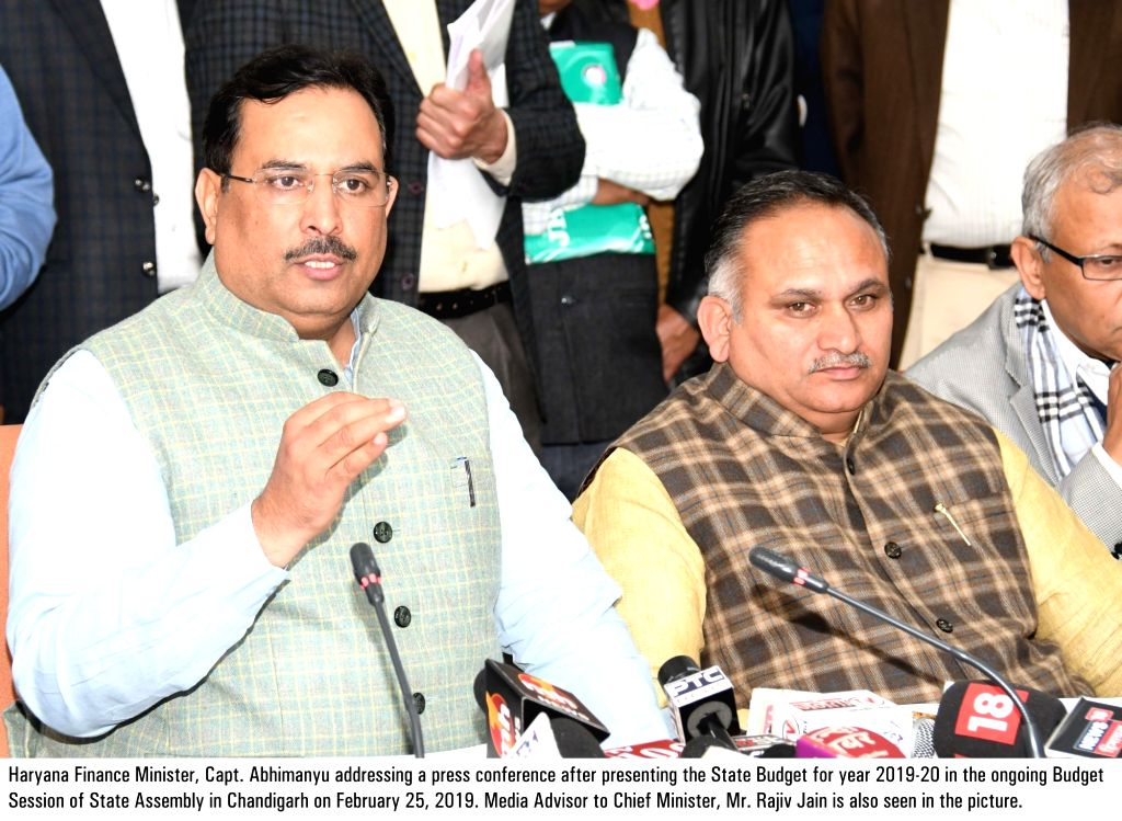 Haryana Finance Minister Abhimanyu addresses a press conference after presenting the state budget 2019 at Haryana Legislative Assembly, in Chandigarh, on Feb 25, 2019. Also seen Haryana ... - Abhimanyu and Rajiv Jain