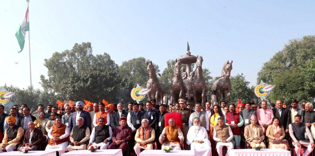 Haryana Governor Satyadeo Narain Arya and Haryana Chief Minister Manohar Lal Khattar perform 'poojan' at Brahma Sarovar during International Gita Mahotsav 2019 in Kurukshetra on Dec 3, ... - Manohar Lal Khattar