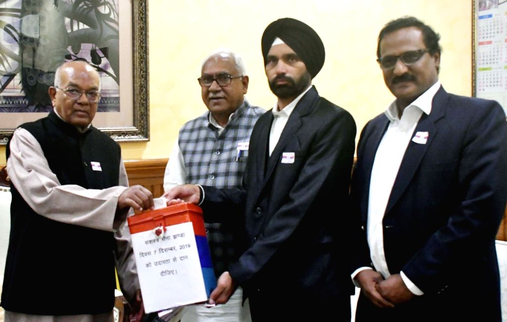 Haryana Governor Satyadeo Narain Arya donates towards Flag Day on the eve of Armed Forces Flag Day, in Chandigarh on Dec 6, 2019.