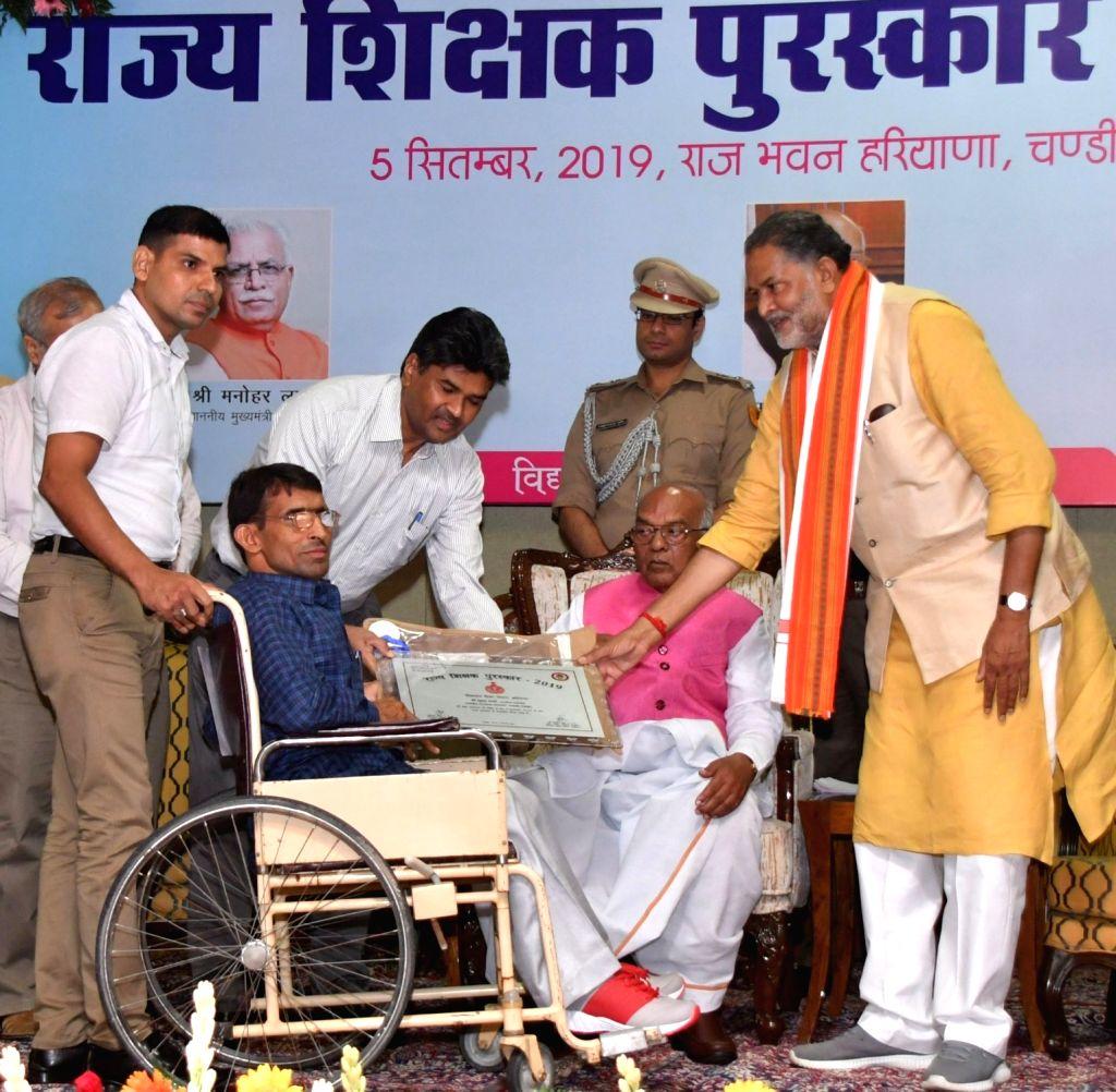Haryana Governor Satyadeo Narain Arya presents Rajya Shikshak Puraskar to a specially-abled teacher on the occasion Teachers' Day in Chandigarh, on Sep 5, 20129.