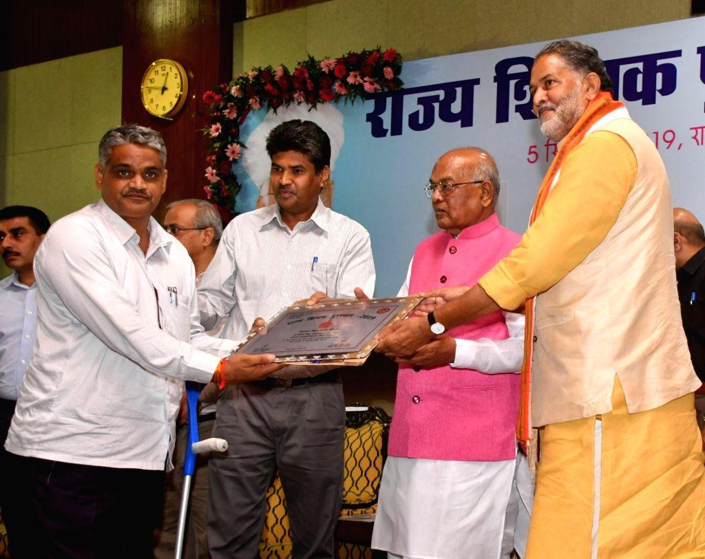 Haryana Governor Satyadeo Narain Arya presents Rajya Shikshak Puraskar to a teacher on the occasion Teachers' Day in Chandigarh, on Sep 5, 20129.