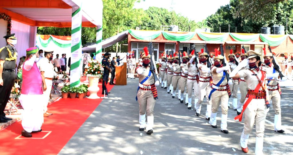 Haryana Governor Satyadeo Narain Arya takes salute from the march past by contingents of the Haryana Police during the 74th Independence Day celebrations at Raj Bhawan in Chandigarh on ...