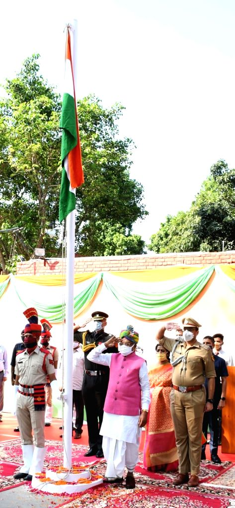Haryana Governor Satyadeo Narain Arya unfurls the national flag on the occasion of 74th Independence Day at Raj Bhawan in Chandigarh on Aug 15, 2020.