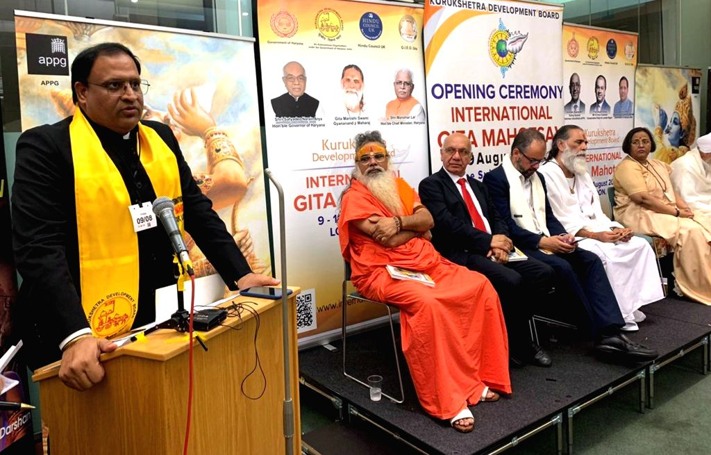 Haryana Industries and Commerce Minister Vipul Goel addresses during the opening ceremony of International Gita Mahotsav in London on Aug 10, 2019. Also seen Members of Parliament of the ... - Vipul Goel and Virendra Sharma