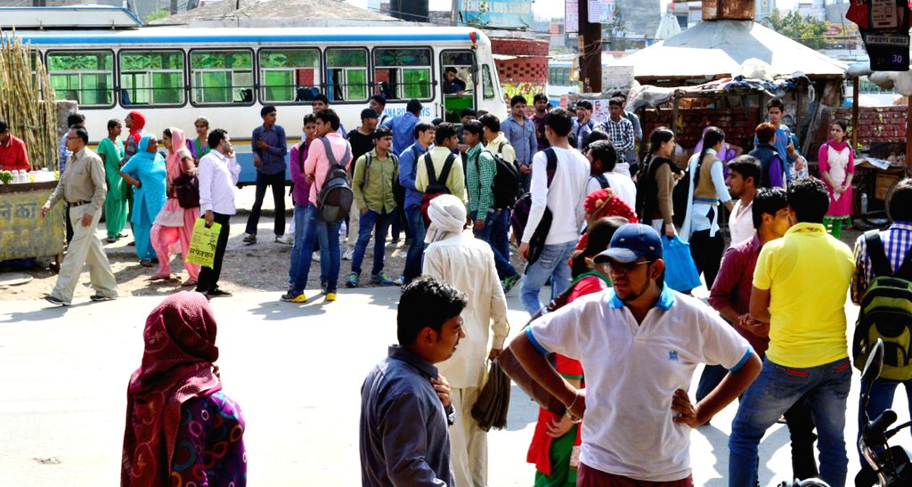 Passengers stranded at a bus stop as Haryana roadways staff go on a strike to protest against the grant of route permits to private bus operators on March 17, 2015.