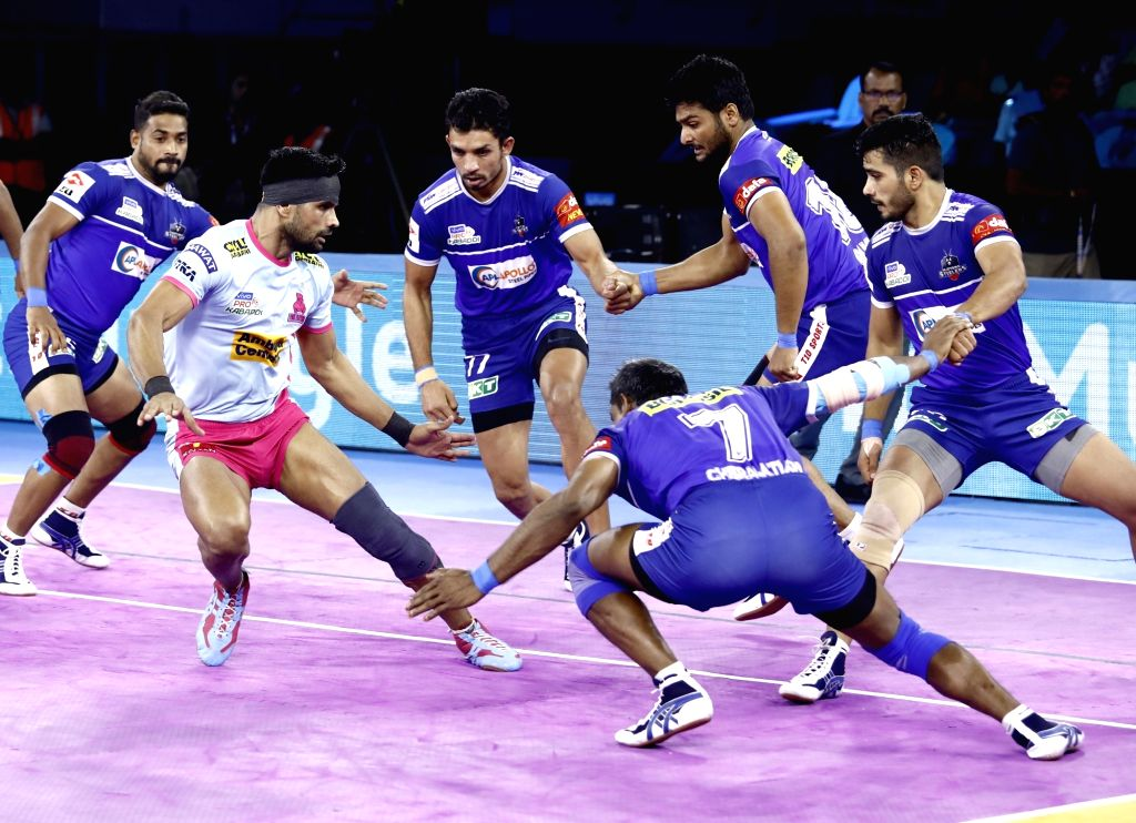 Haryana Steelers players tackle a raider.