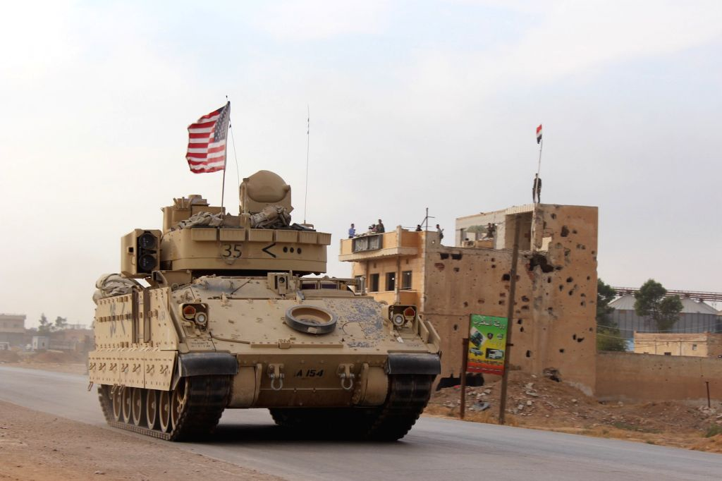 HASAKAH (SYRIA), Nov. 14, 2019 A U.S. military vehicle runs past the Tal Tamr area in the countryside of Hasakah province, northeastern Syria, on Nov. 14, 2019.