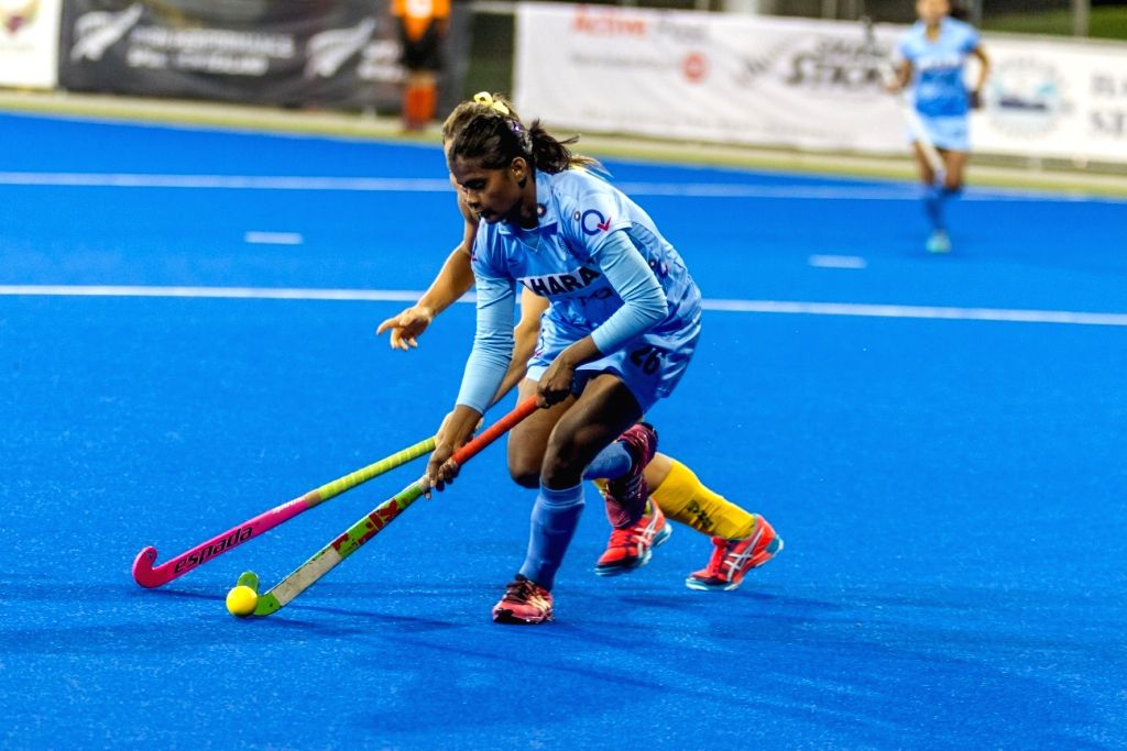 The players of the Indian and the Australian women hockey team in action during a Hawke`s Bay Cup match in Hastings, New Zealand on April 14, 2015. Match Draw Score: 0-0.