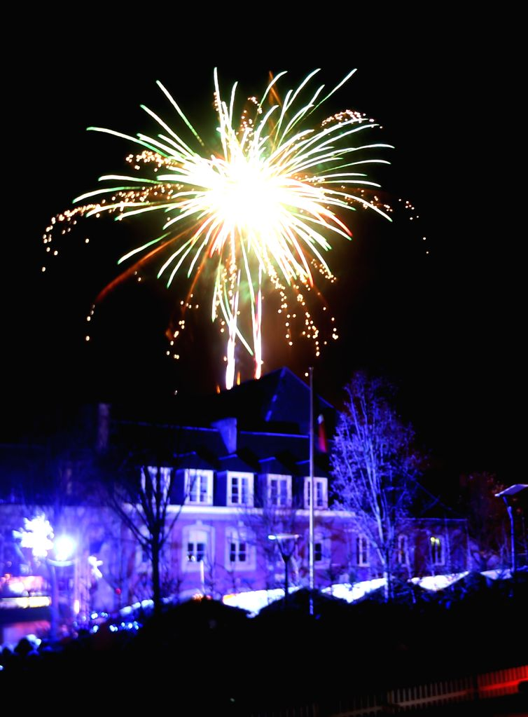Fireworks are seen at the Christmas market in the city of Hautmont, northern France, Dec. 14, 2013.