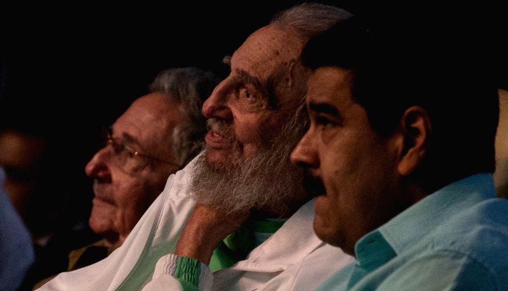 HAVANA, Aug. 14, 2016 - Photo provided by Cubadebate shows Cuba's revolutionary leader Fidel Castro (C), alongside Venezuelan President Nicolas Maduro (R), enjoying a gala in honor of his 90th ...