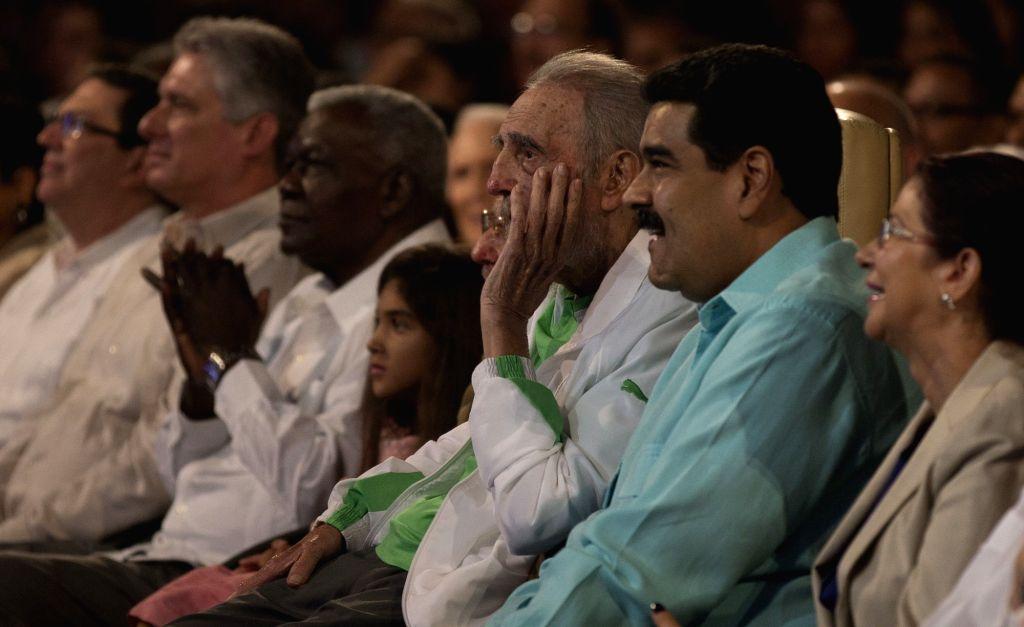 HAVANA, Aug. 14, 2016 - Photo provided by Cubadebate shows Cuba's revolutionary leader Fidel Castro (3rd R), alongside Venezuelan President Nicolas Maduro (2nd R), enjoying a gala in honor of his ...