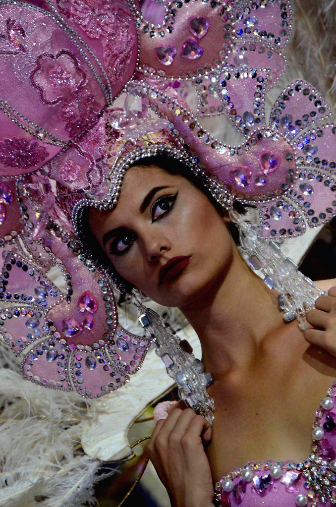 HAVANA, Aug. 20, 2017 - Photo taken on Aug. 18, 2017 shows a woman taking part in the Havana Carnival, one of Cuba's oldest popular celebrations, in Havana, Cuba.
